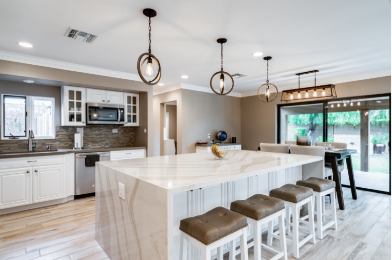 Kitchen renovations in Glendale, AZ with marble waterfall island and bar stool seating