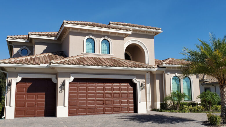 New home construction in Glendale, AZ, two story home with 3 car garage and arched windows